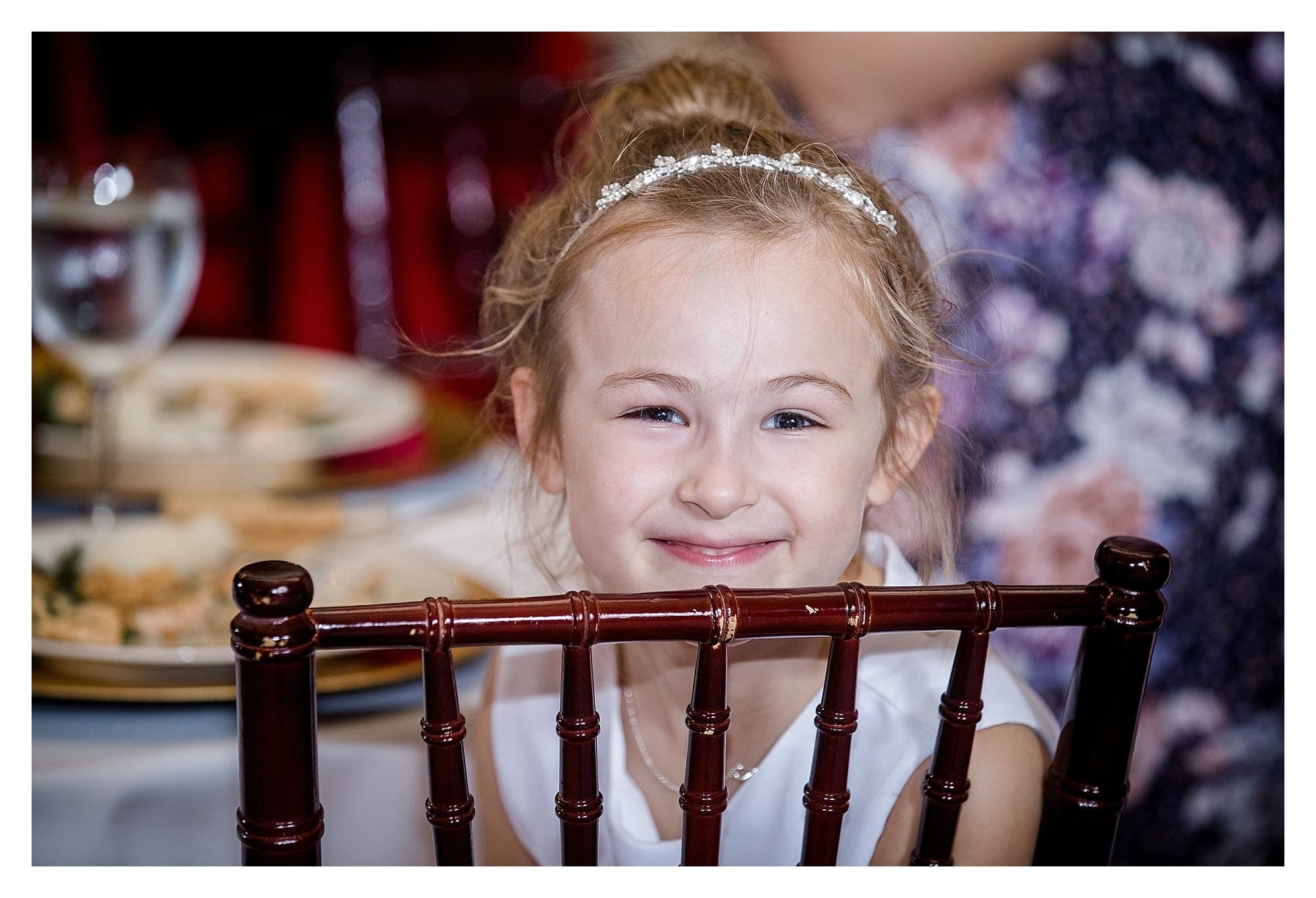 Smiling girl at wedding reception, photography by Kathy Beaver