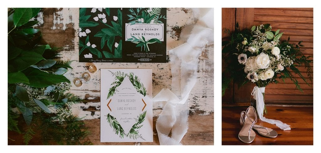 Green and black wedding invitation with second image of cream bouquet and greenery leaning against wood wall - kathy beaver photography