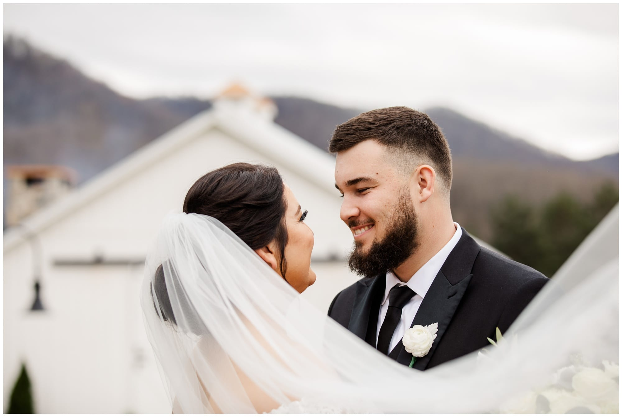 Veil Photo with bride and groom with venue in background