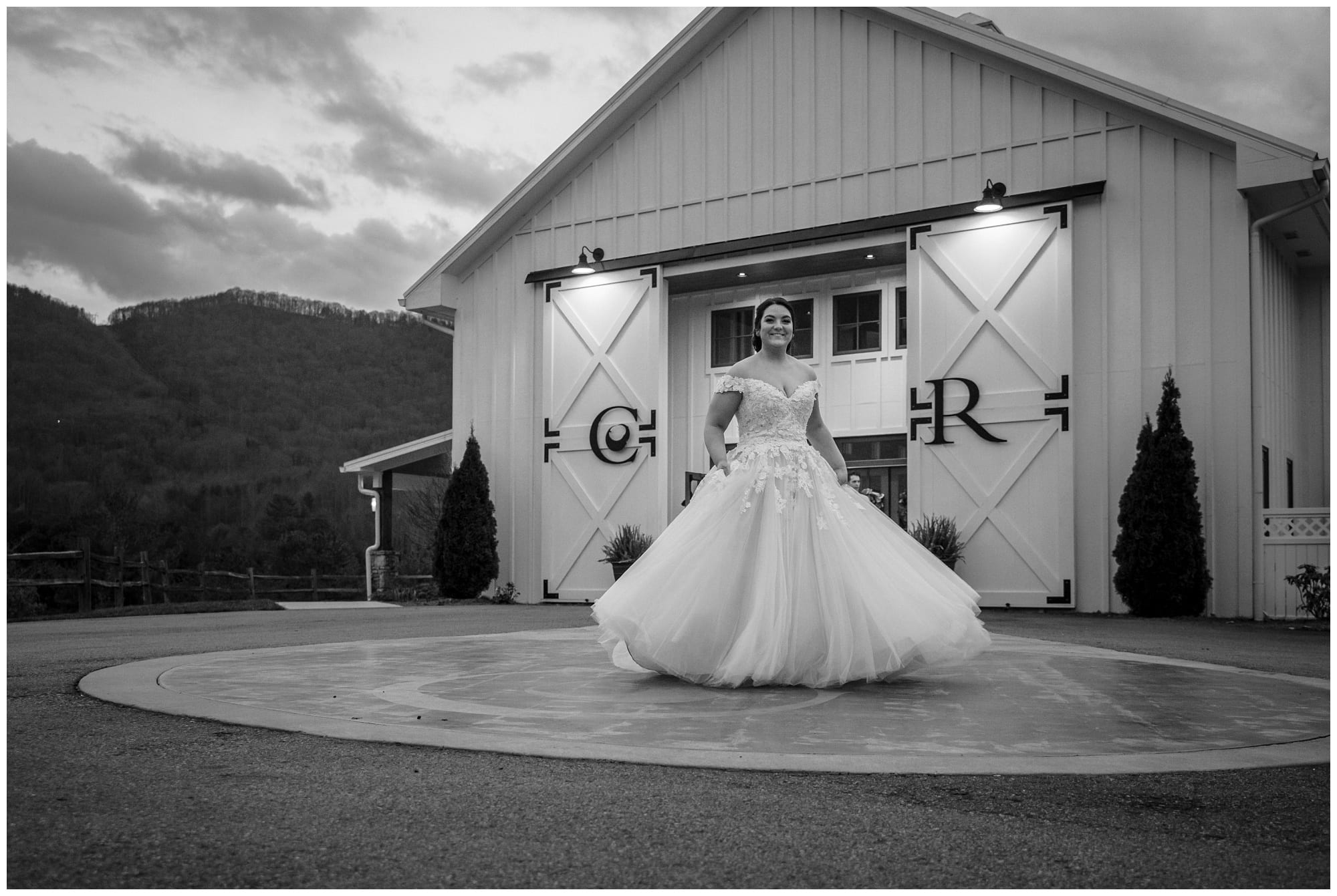 bride in front of barn doors at wedding venue