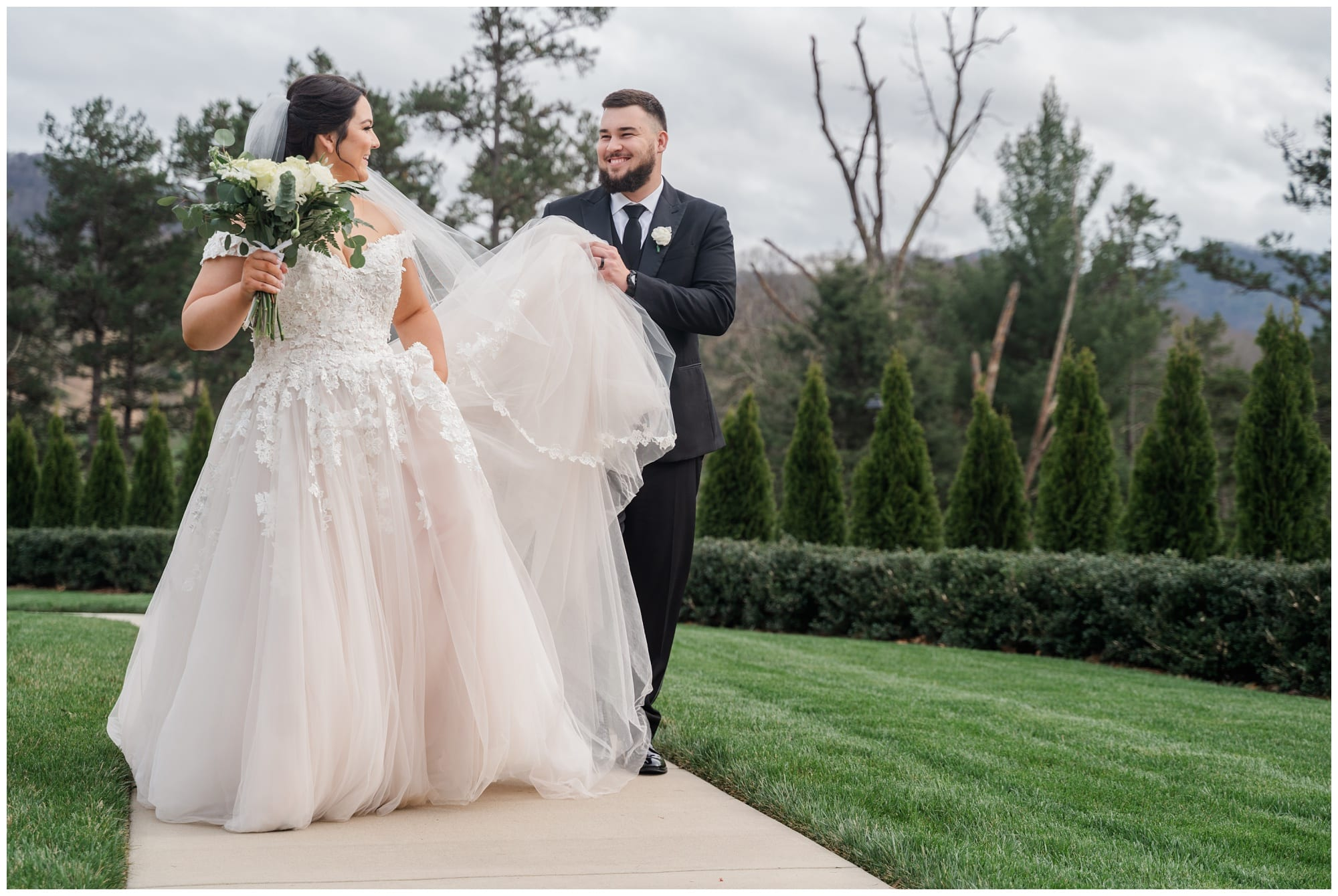 goom helps bride with her dress